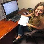 Emily Meister at her desk