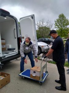 Volunteers dropping off food at a recipient agency