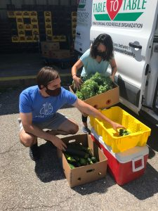 Dropping off veggies at Coralville Community Pantry