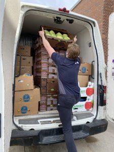 Taveon loads cabbages into T2T van