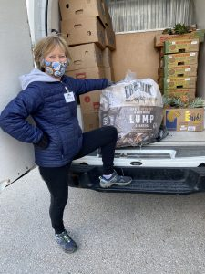 Nancy with charcoal donation