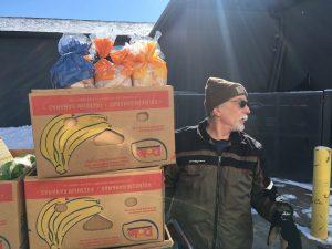 Steve Gallagher unloads food at CommUnity