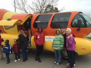 Mary Palmberg with group in front of Oscar Mayer Weinermobile